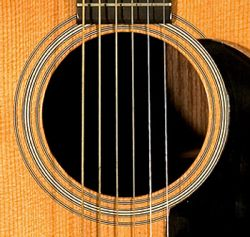 on-music-09-martinguitarsoundhole-250px.jpg
